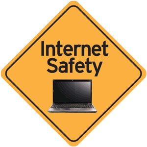 "Yellow caution sign with a computer in it and the words ""Internet Safety"""