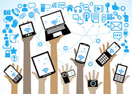 Clipart picture of hands in the air holding different digital devices like phones, tablets and laptops.