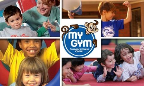 My Gym logo in the center of a photo collage with children smiling.